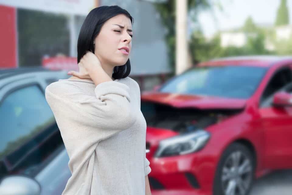 Woman Grabbing Neck After a Car Accident