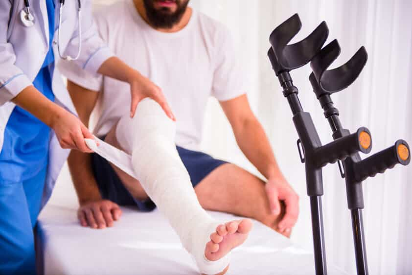 Doctor Wrapping Man's Cast
